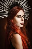 picture of spike  - Closeup portrait of a beautiful gothic girl wearing spiked headgear - JPG
