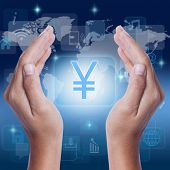 stock photo of yen  - Hand Yen sign JPY currency symbol on screen - JPG