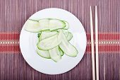 picture of cucumbers  - Japanese cucumber salad with thinly sliced cucumbers in white plate