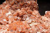 stock photo of calcite  - some bright orange colored Spanish aragonite mineral  - JPG