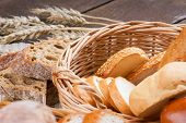 image of fresh slice bread  - Sliced fresh bread on a table and in a basket - JPG