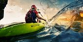 picture of hard-on  - Young lady paddling hard the kayak with lots of splashes - JPG