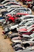 stock photo of junk-yard  - Scrap Yard With Pile Of Crushed Cars in tenerife canary islands spain - JPG