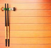foto of chopsticks  - Traditional Vietnam table setting with chopsticks on a wood table top - JPG