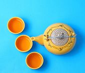 foto of ceremonial clothing  - Asian tea set served on a blue table cloth - JPG