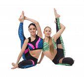 foto of do splits  - Pretty gymnasts posing while doing vertical split - JPG