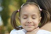 pic of mums  - Portrait of happy smiling little girl on a shoulder at mum close - JPG