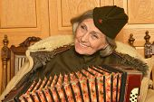 pic of accordion  - Cute elderly woman solder playing accordion closeup - JPG