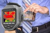 stock photo of thermal  - Recording Businessman With tablet using Infrared Thermal Camera - JPG