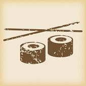 image of chopsticks  - Grungy brown icon with image of sushi rolls and chopsticks - JPG