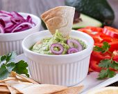image of nachos  - Guacamole in porcelain Bowl with mexican Tortilla Chips nachos and Ingredients - JPG