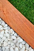 stock photo of combinations  - Landscaping combinations of grass timber and stones - JPG