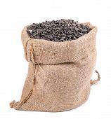 stock photo of semen  - Close up of black sunflower seeds in bag - JPG