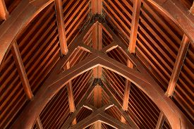 foto of rafters  - Abstract view of timber rafter beams of an old building - JPG