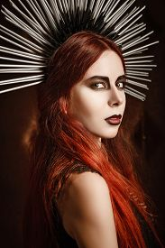 picture of headgear  - Closeup portrait of a beautiful gothic girl wearing spiked headgear - JPG