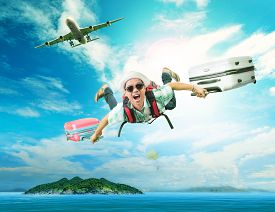 foto of surrealism  - young man flying from passenger plane to natural destination island on blue ocean with happiness face emotion use for people traveling on vacation holiday in summer season - JPG