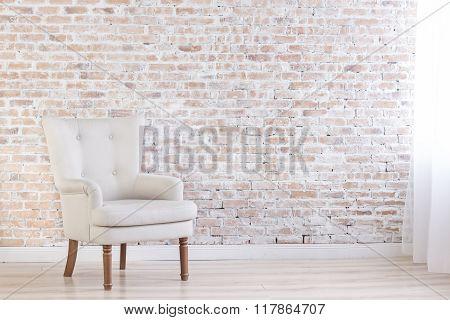 White Armchair In Loft Interior