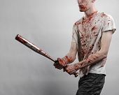 ������, ������: Bloody Topic: The Guy In A Bloody T shirt Holding A Bloody Bat On A White Background