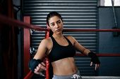 Female Boxer Training Inside A Boxing Ring poster