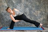 Woman Doing Yoga Posture Parsvakonasana Or Bound Extended Side Angle Pose