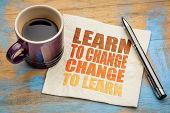 Learn to change, change to learn -  word abstract on a napkin with a cup of espresso coffee poster
