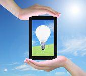 foto of light-bulb  - light bulb on tablet PC in women hand - JPG