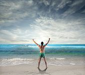 stock photo of open arms  - Man stretching at the seaside - JPG