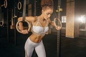 Workout On Crossfit Rings Fitness Woman The In Gym. Fit Power Athletic Confident Young Woman Crossfi poster