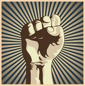 stock photo of revolt  - illustration in retro style of a clenched fist held high in protest - JPG