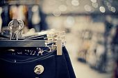 Shopping In Store. Clothes On Hangers In Shop For Sale. Blur Background. Fashionable Clothes In A Bo poster