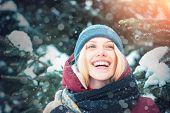 Smiling Snowy Woman On Winter Nature Background. Christmas And New Year. Model Tender Girl Warm Hat  poster