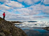Global warming -Greenland Iceberg landscape of Ilulissat icefjord with giant icebergs. Icebergs from poster