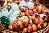 Beautiful Christmas Decorations In The Basket. Christmas Tree Decorations And Decorations In The Des poster