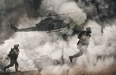 Military Helicopter And Forces Between Fire And Dust In The Battlefield At Sunset / Focus On Helicop poster