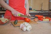 Woman Hands Cutting Vegetables In The Kitchen. Preparing Dishes. Woman In Kitchen Preparing Vegetabl poster