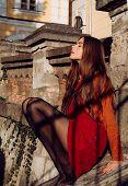 Gorgeous Woman Enjoy Sunny Day Outdoors. Fall Outfit. Modern Fashion Outfit. Autumn Season. Pretty W poster