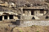 picture of ellora  - Buddhist cave temples carved out of the solid rock of the hillside at Ellora Caves in India - JPG