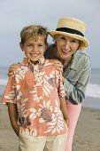 stock photo of early 50s  - Grandmother and Grandson on Beach - JPG