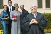 stock photo of ecclesiastical clothing  - Smiling Preacher with Congregation - JPG