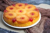 Pineapple Upside Down Cake In A Rustic Setting poster