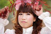 foto of lolita  - japanese lolita portrait in  fall season - JPG