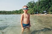 Cute Funny Caucasian Boy Swimming In Lake River With Underwater Goggles. Child Diving In Water On Be poster
