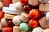 Different Colorful Pills And Capsules Stacked. Global Pharmaceutical Industry For Billions Dollars P poster