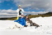 picture of wallow  - Young people are enjoying the sun and snow wallowing in the snow - JPG