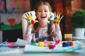 Happy Funny Child Girl Draws Laughing Shows Hands Dirty With Paint poster