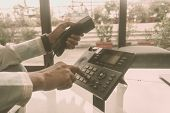 Close Up Male Of Hand Holding Telephone Receiver And Dialing A Telephone Number To Make A Call Using poster
