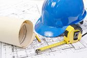 pic of hard_hat  - Blue hard hat yellow pencil measuring tape and building plans - JPG