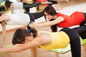 picture of health center  - Group training in a gym of a fitness center - JPG