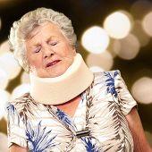 pic of neck brace  - A Senior Woman Wearing A Neck brace - JPG