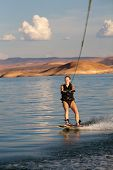 Blonde Woman Wakboarding At Sunset